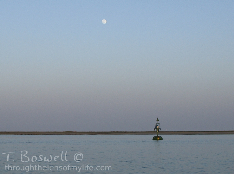 Buoy and moon in the Algarve, Portugal.