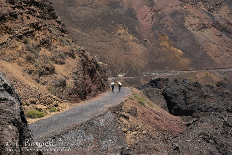 20150506-DSC00184-2-fogo-cape-verde-movel-barren-rocky-mountains-men-carrying-bags-terry-boswell-wm
