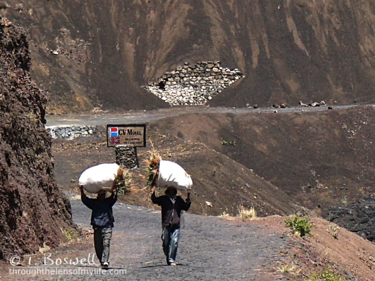 20150506-DSC00184-2cp-fogo-cape-verde-movel-barren-rocky-mountains-men-carrying-bags-terry-boswell-wm